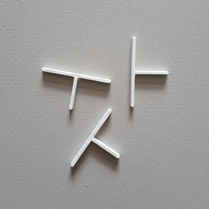 Flīžu krustiņi T-veida